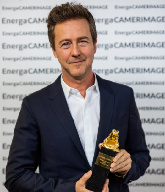 Edward Norton with award
