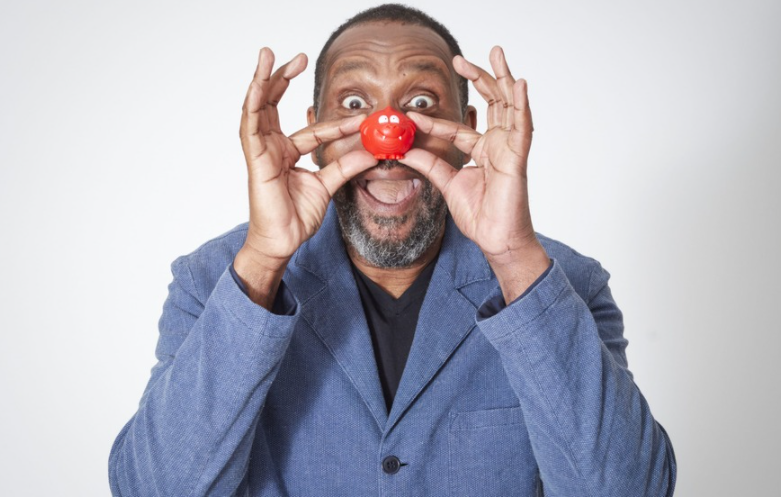 Lenny Henry, a famous stand-up comedian, actor, singer, writer, and television presenter