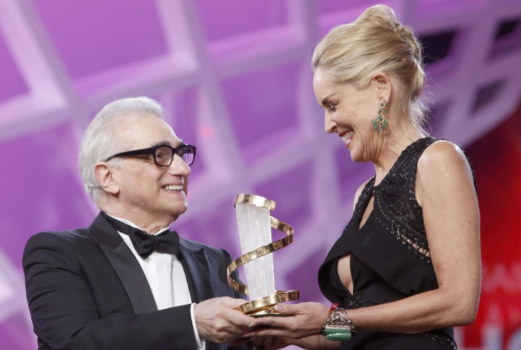 Sharon Stone receives a trophy in tribute to her lifetime career, from American film director Martin Scorsese