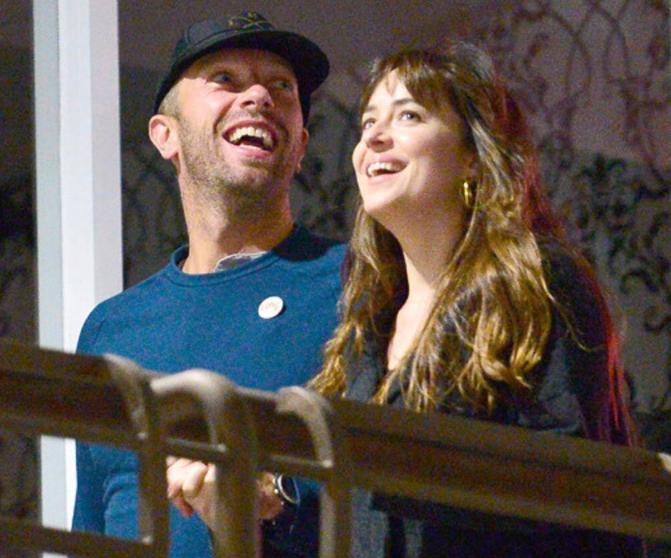 Dakota Johnson with her boyfriend Chris Martin