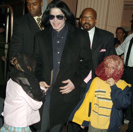 Michael Jackson walks with his children, Prince and Paris in 2005