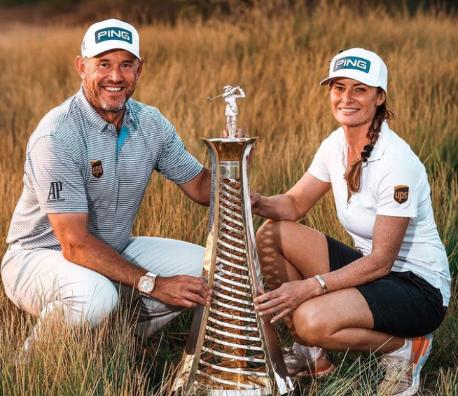 Golfer Lee Westwood and his caddie girlfriend, Helen Storey with trophy
