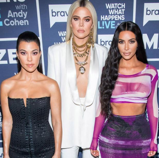 Khloe Kardashian with her sisters, Kim and Kourtney