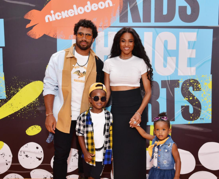 Russell Wilson with his wife, Ciara and their kids