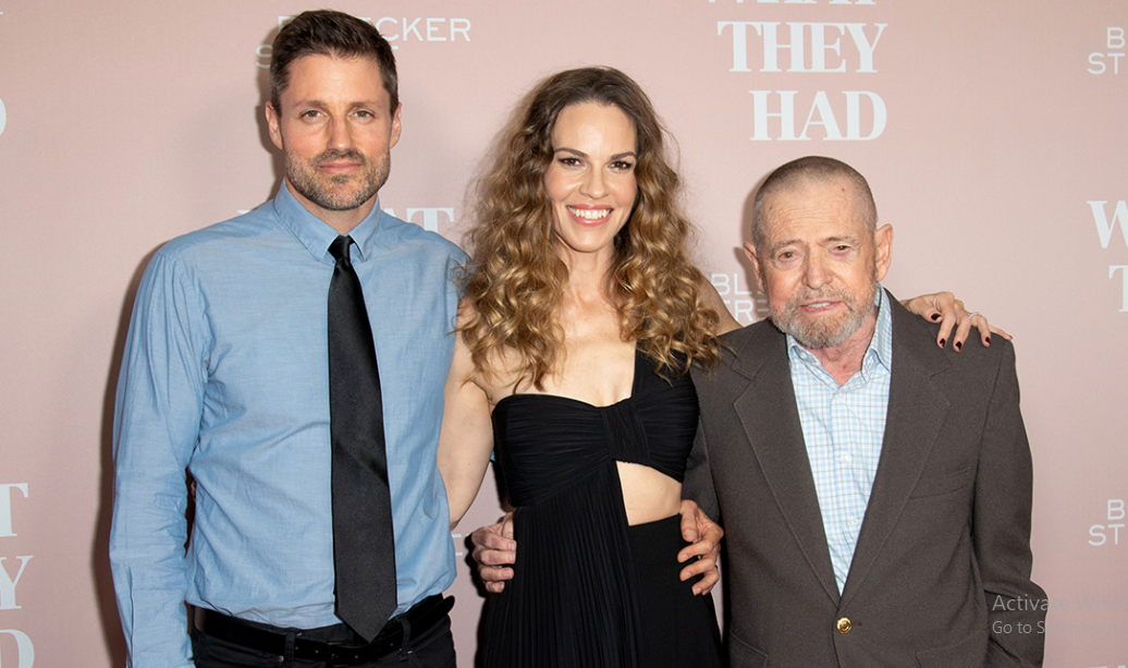 Hilary Swank (center) with husband Phillip Schneider (left) and dad Stephen Michael Swank (right)