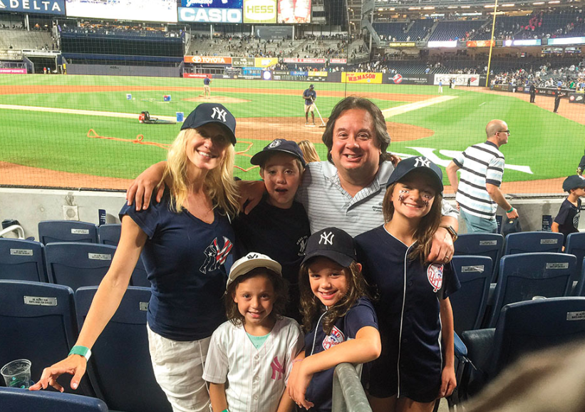 Kellyanne Conway with her husband George and their children