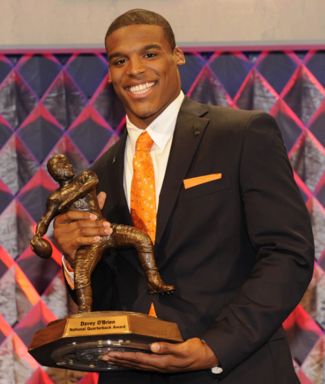 Cam Newton with Heisman Award