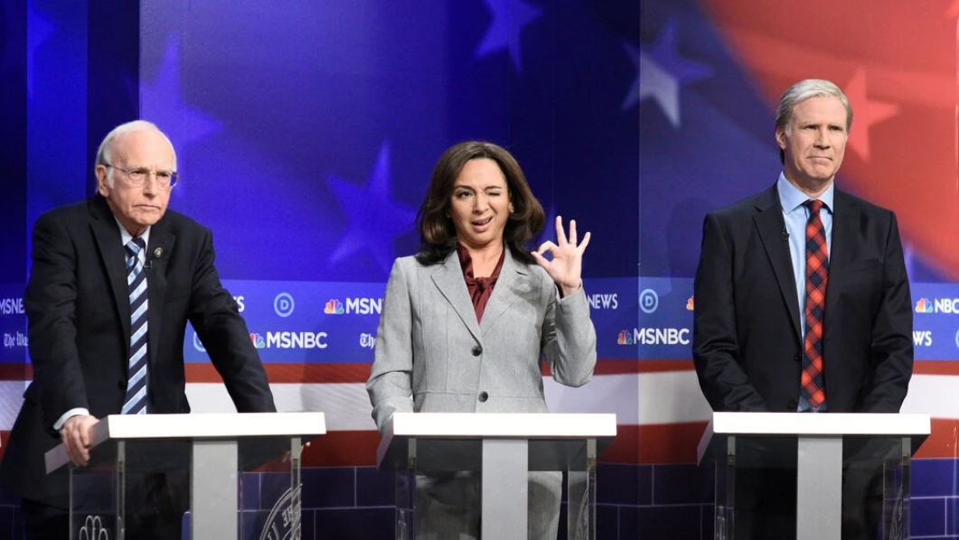 Maya Rudolph as Kamala Harris with Larry David, left, as Bernie Sanders and Will Ferrell as Tom Steyer during a Democratic debate sketch on SNL