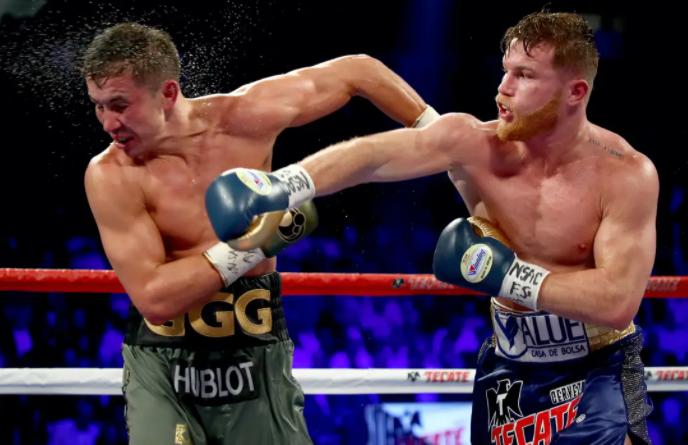 Canelo Alvarez punching against the opponent