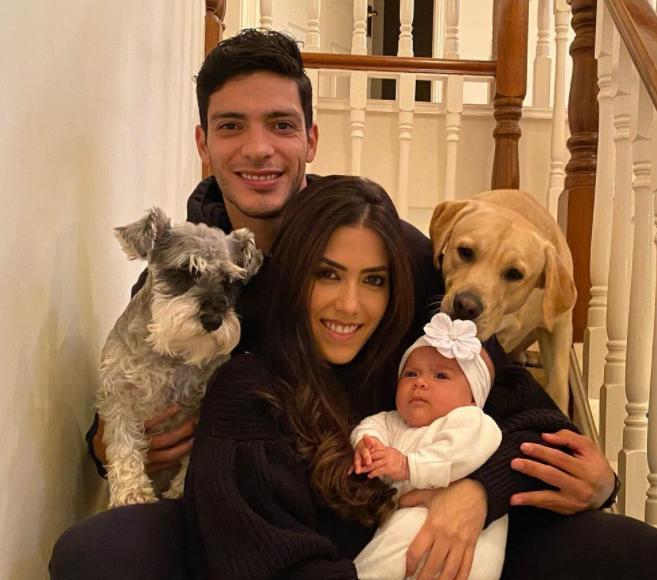 Raul Jiminez with his girlfriend, Daniela Basso and their kid
