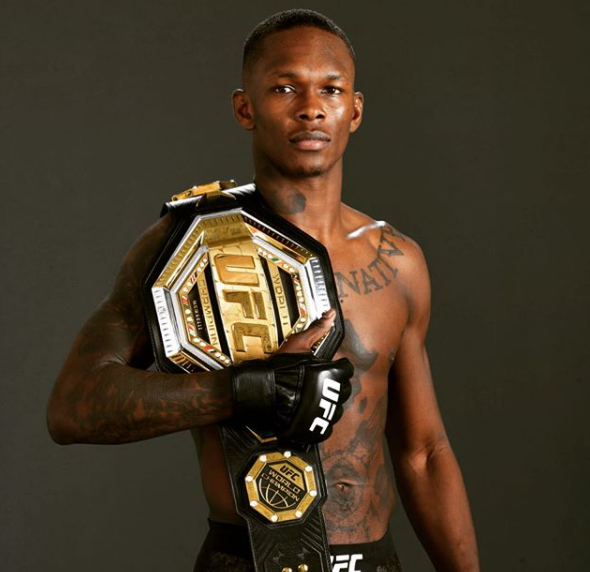 Israel Adesanya with UFC belt