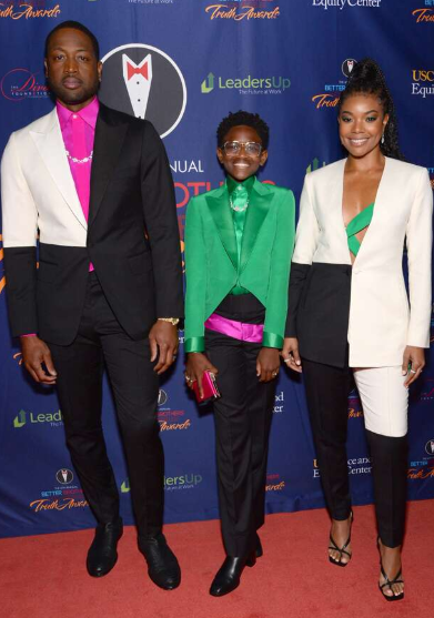 Zaya Wade Walking In A Red Carpet With His Parents