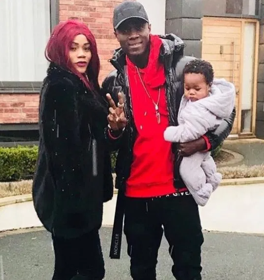 Eric Bailly with his wife and son