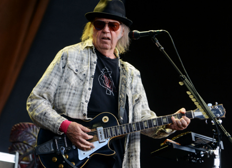 Neil Young Singing With Guitar