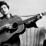 Bob Dylan at his young age with guitar