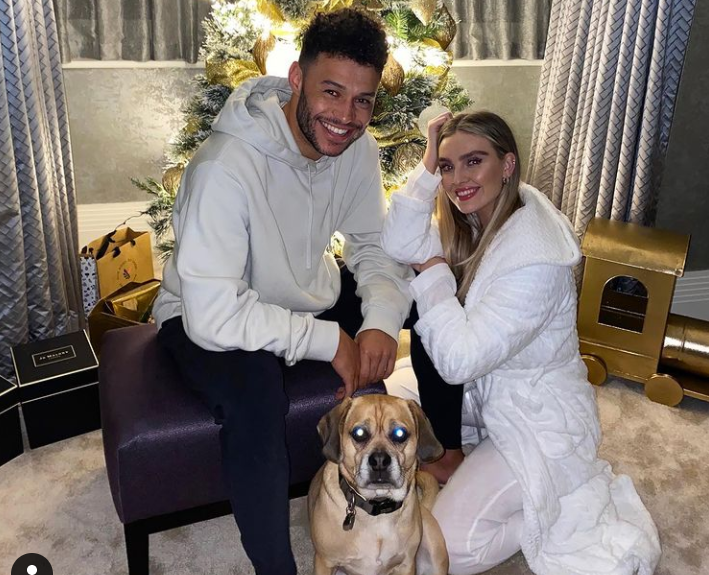 Perrie Edwards with her boyfriend, Alex Oxlade-Chamberlain During Christmas