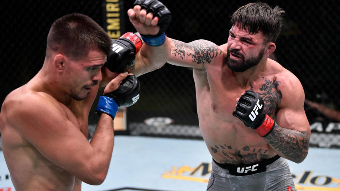 Mickey Gall blocking against the punch of Mike Perry