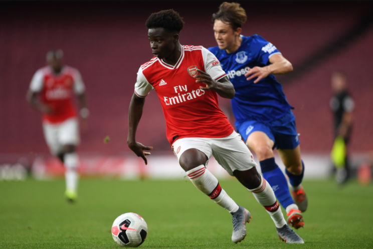 Bukayo Saka Heading The Ball Against The Opponent