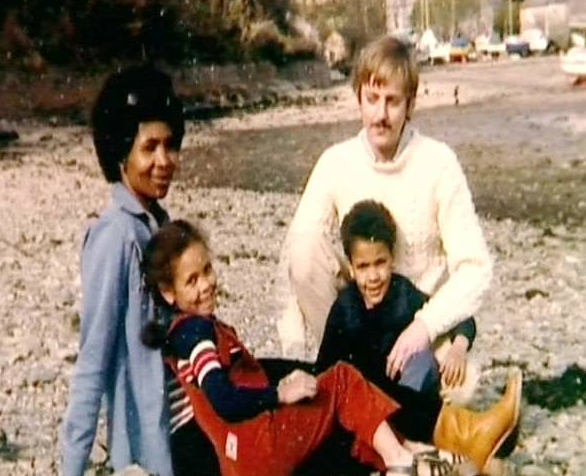 Thandie Newton's Childhood Picture with her mom, dad and brother