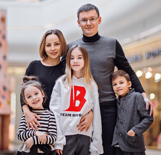 Daneliya Tuleshova with her parents and two siblings