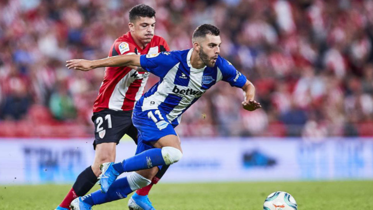 Luis Rioja Heading The Ball Against The Opponent