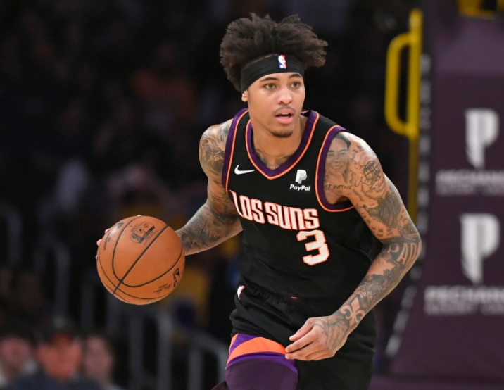 Kelly Oubre Jr. heading the ball