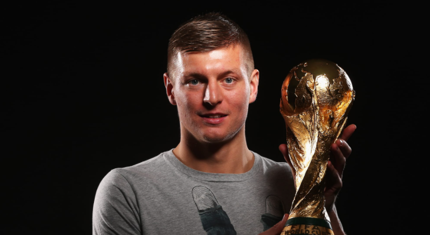 Toni Kroos Holding World Cup Trophy