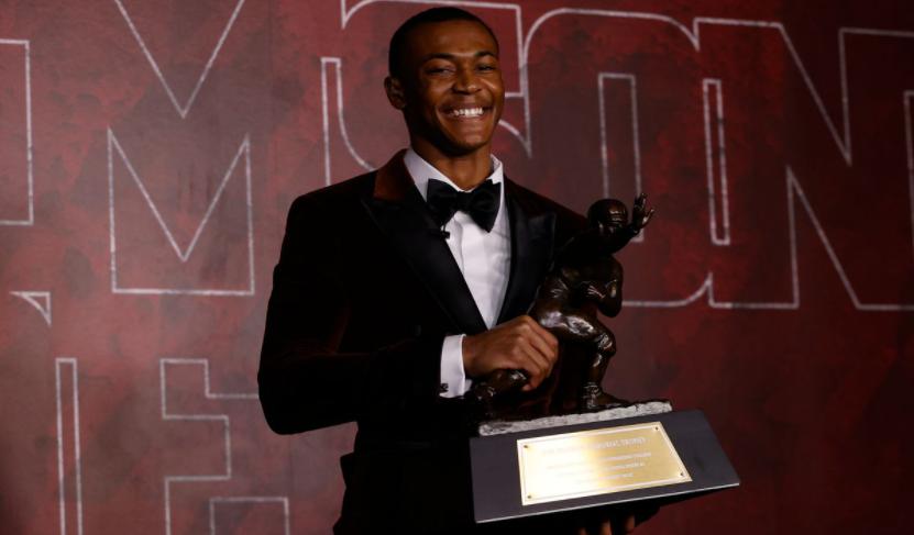 Alabama wide receiver DeVonta Smith holds the Heisman Trophy