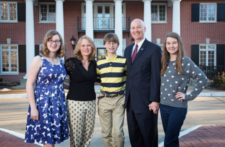 Pete Ricketts with his wife and their kids