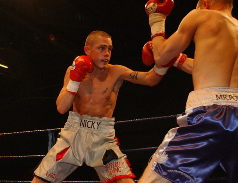 Nicky Booth fighting against the opponent