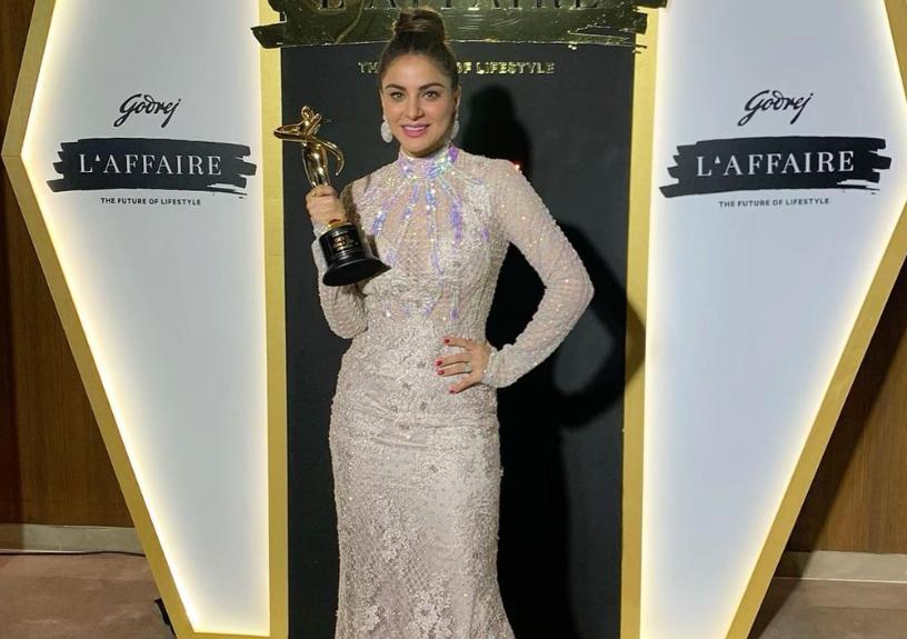 Shraddha Arya Holding Her Award