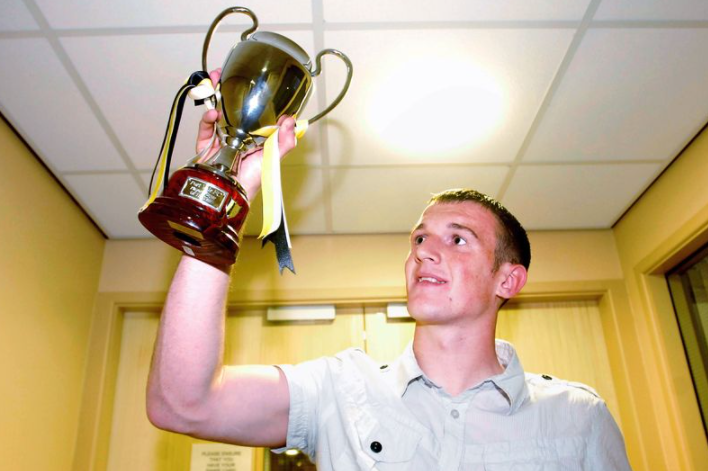 Lee Collins Holding The Trophy
