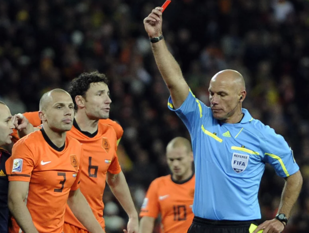 Referee Howard Webb of England, shows the red card to Netherlands' John Heitinga during the World Cup 2010 final soccer match