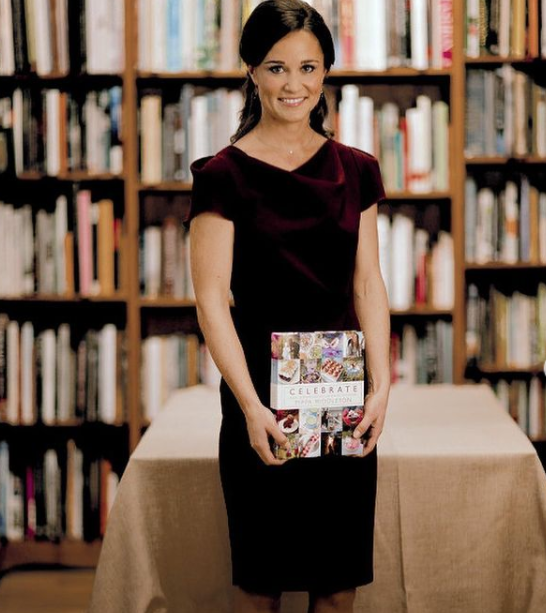 Pippa Middleton poses for photos as she promotes her book 'Celebrate A Year Of Festivities For Family and Friends' at Daunt Books in London