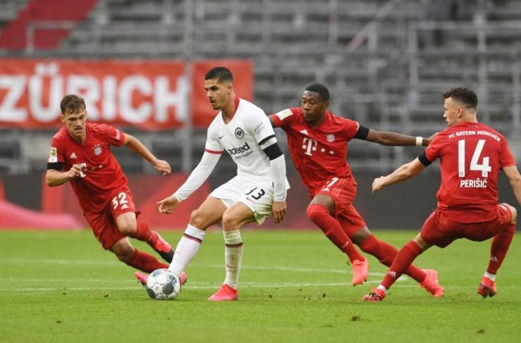 Andre Silva heading the ball against the opponent